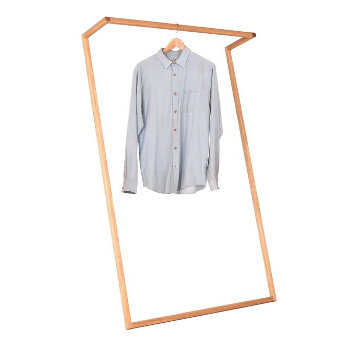 """Heimer 'Leaning' black butt **clothes rack**, $225, from [Handkrafted](https://www.handkrafted.com/heimur/1667555/leaning-clothes-rack