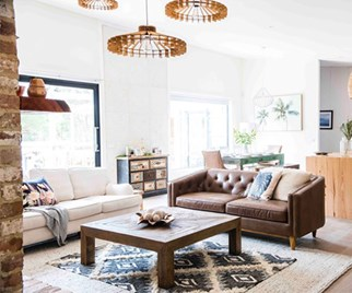 Coastal style living room with sisal rug and leather couch