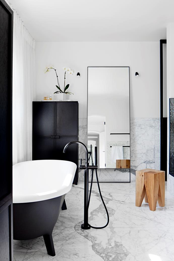 The main bathroom has an Agape 'Ottocento' freestanding bath from Artedomus. Mirror and custom joinery by Hecker Guthrie.