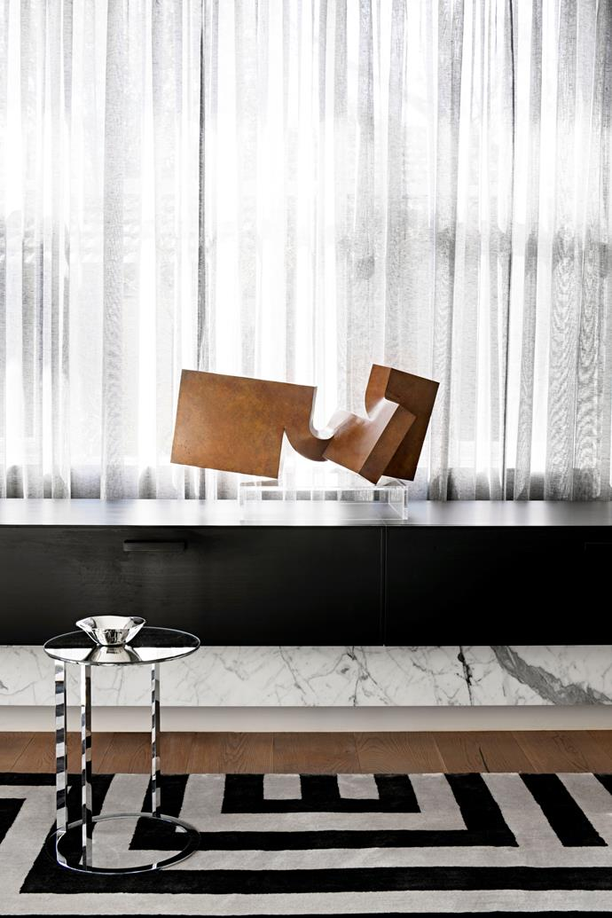 A Clement Meadmore sculpture sits on a custom-designed bench. Maxalto 'Lithos' table from Space holds a Georg Jensen bowl.