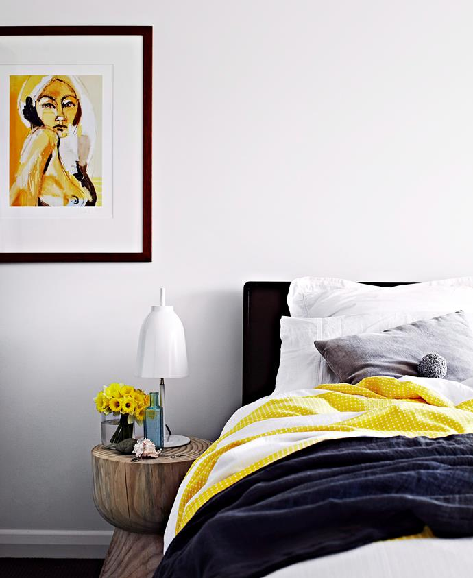 Splashes of yellow are like a ray of sunshine in this monochrome bedroom. Photo: Sharyn Cairns / bauersyndication.com.au