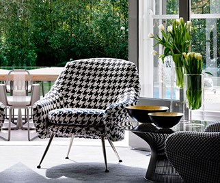 Houndstooth armchair in front of open French doors