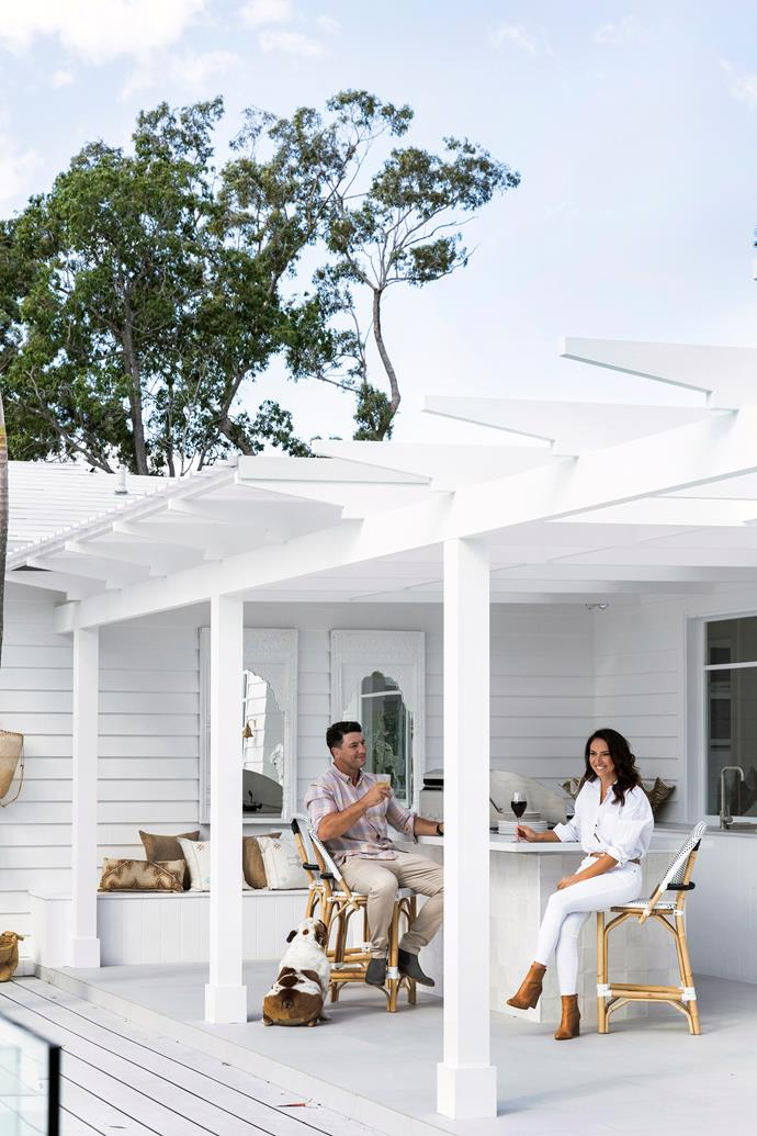 Nathan and Bonnie, pictured with British bulldog Peanut Butter at their feet, enjoy the fruits of their labours. Scyon 'Linea' cladding painted Dulux Snowy Mountain Quarter.The decking is fire-resistant HardieDeck boards.