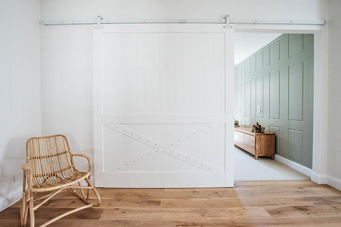 The couple mixed up their use of doors in the home, opting to use on-trend barn door fittings for the walk in wardrobes, kids room and hallway.