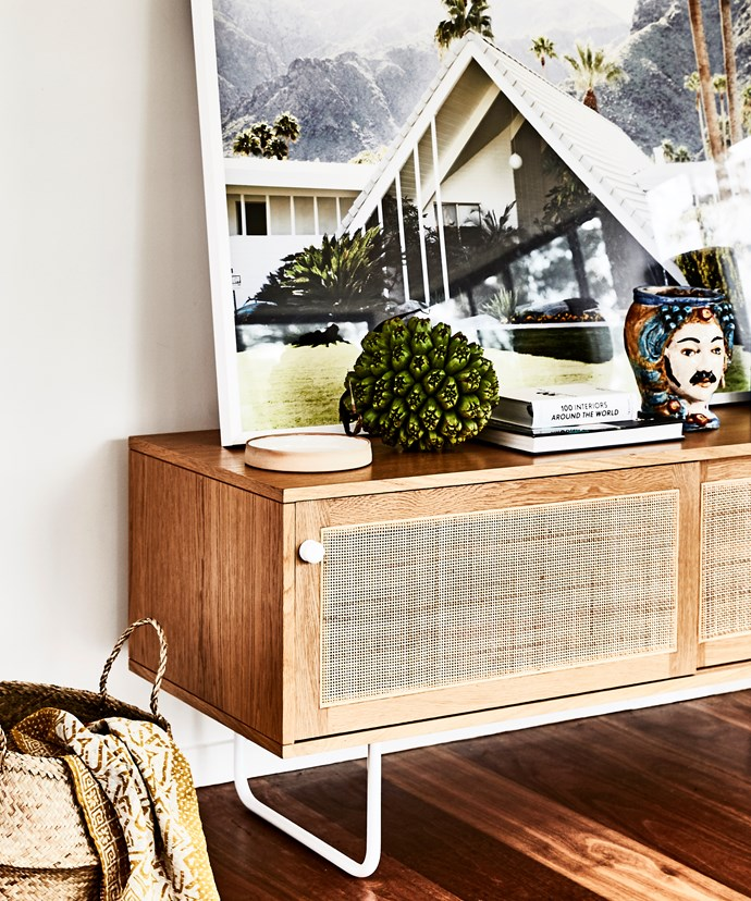 "Another corner of the open-plan living area has a decidedly [mid-century modern retro](https://www.homestolove.com.au/mid-century-retro-interiors-4189|target=""_blank"") air, with an Iluka sideboard from Jardan and Swiss Miss photo of Palm Springs by James Geer."