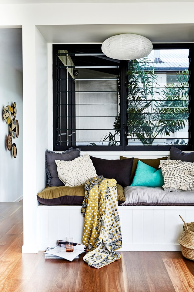 "This built-in daybed was the perfect solutions for converting wasted space into a chill zone. ""It's a great spot to relax and catch the breeze"", says Lauren - the owner of this [pavilion style home](https://www.homestolove.com.au/pavilion-style-home-6808