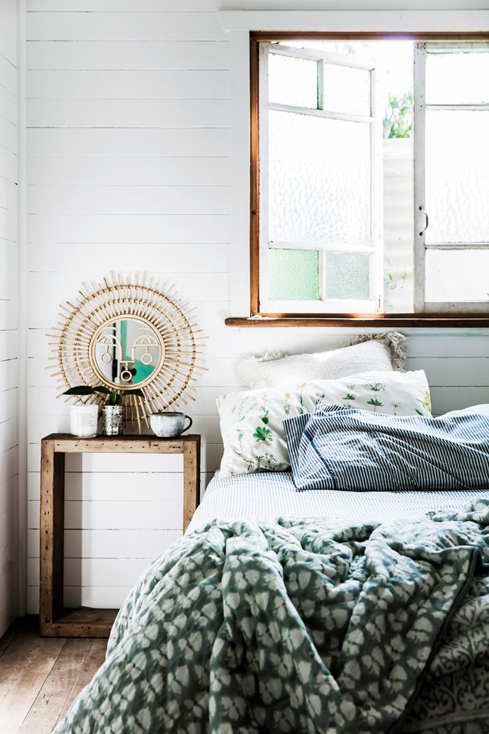 The couple replaced all of the home's existing aluminium windows – including these in the bedroom – with recycled wooden frames to bring it back to its original state.