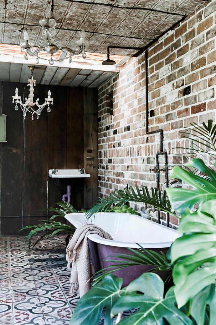 Sonya and Anthony converted a little tool shed in the garden into one of their three bathrooms. The bathtub was a Gumtree find that they had re-enamelled on the inside, while the antique tiles are, of course, Jatana.