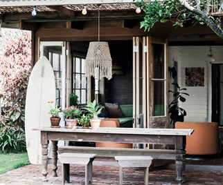 Outdoor dining area of bohemian style beach shack