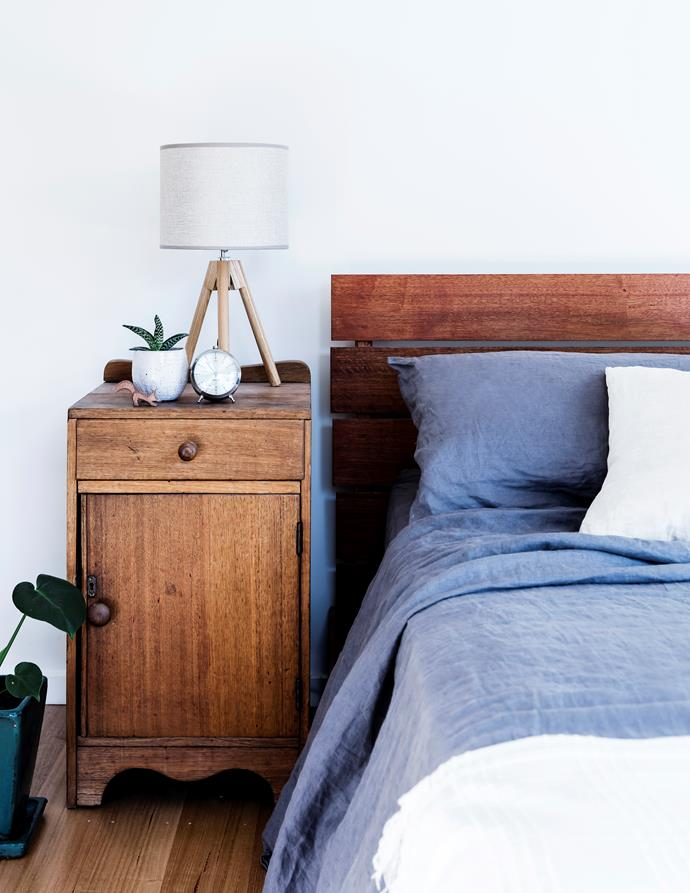 "Kinara found the bedside table at a local op shop. ""I just had to put a new latch on it and it's as good as new,"" she says. Andrew made the Tasmanian oak bed."