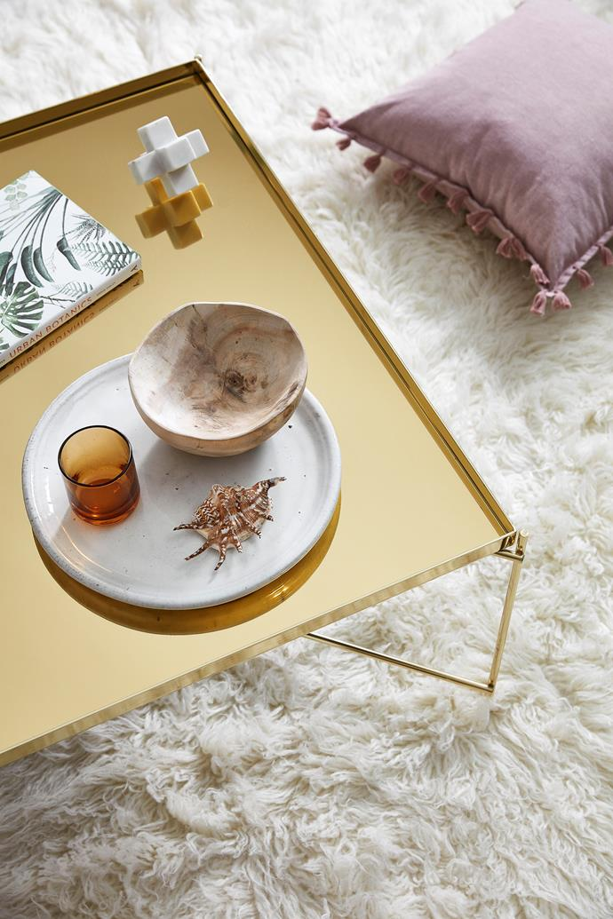 A gold coffee table adds a touch of LA glamour.