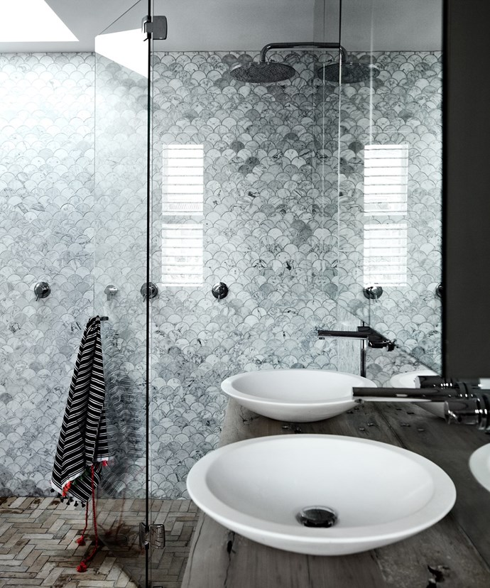 Contrasted with a dark wooden vanity, grey Carrara fan-shaped tiles add depth and opulence to this skylight-lit bathroom. *Photo: Sharyn Cairns / Bauersyndication.com.au*