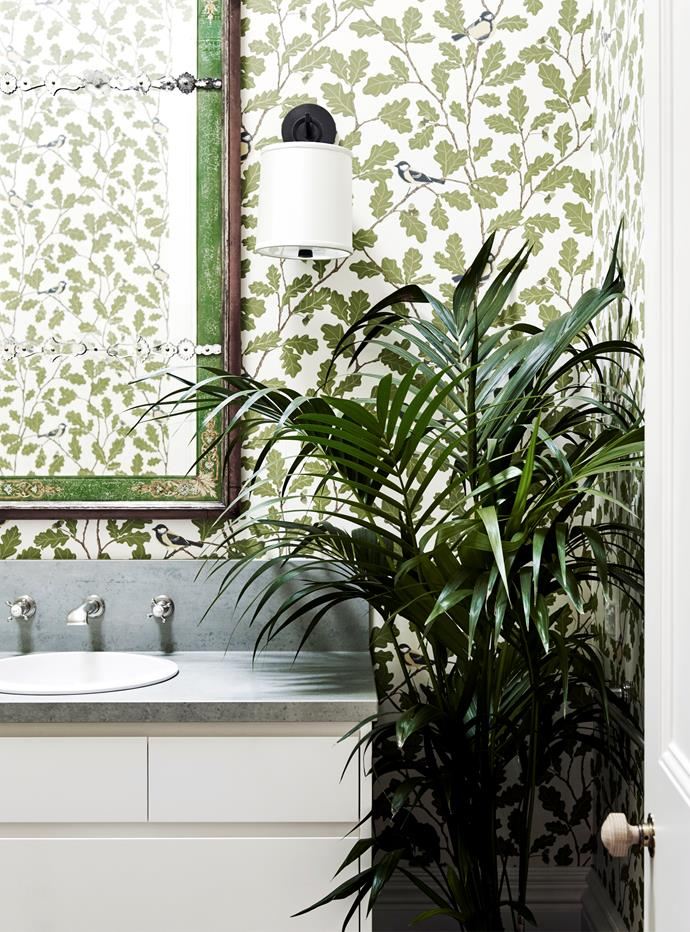 "Sandberg 'Waldemar' [statement wallpaper](https://www.homestolove.com.au/wallpaper-feature-wall-ideas-5579|target=""_blank"") from Ascraft in the powder room was chosen to reflect the oak trees in the garden."