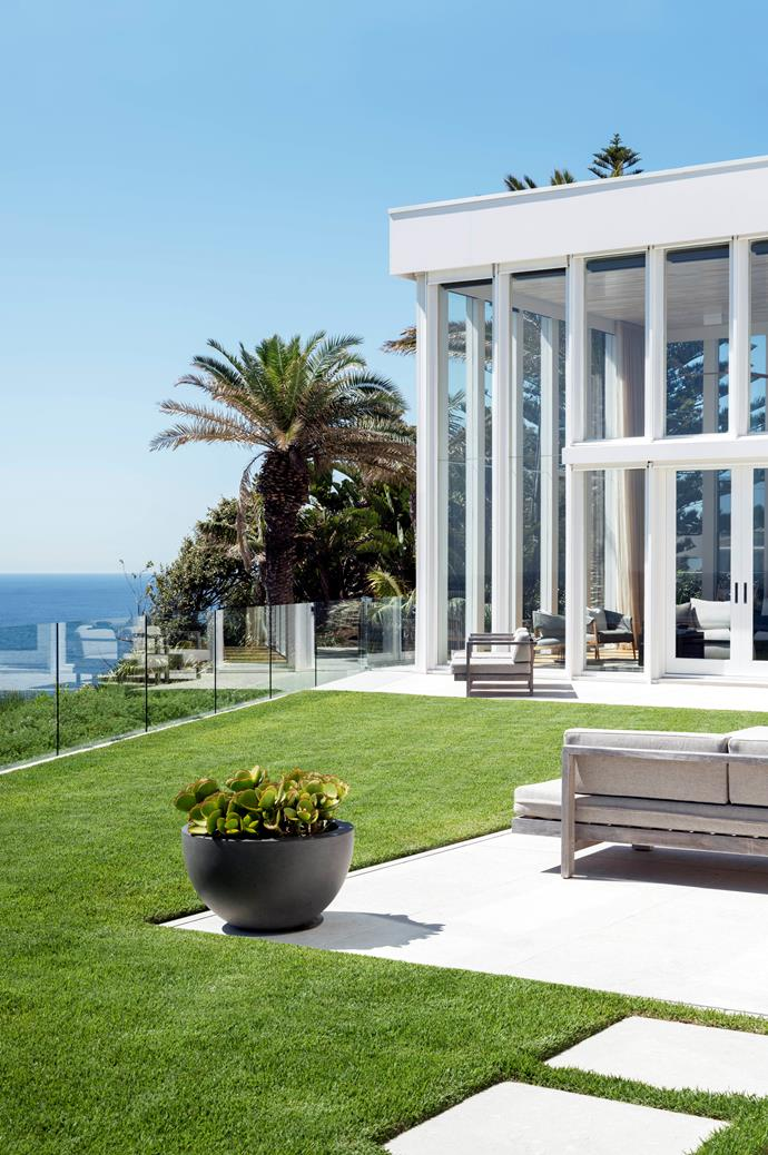 The expansive zoysia lawn and ocean views. Bowl planted with *Cotyledon macrantha* or paddle plant.