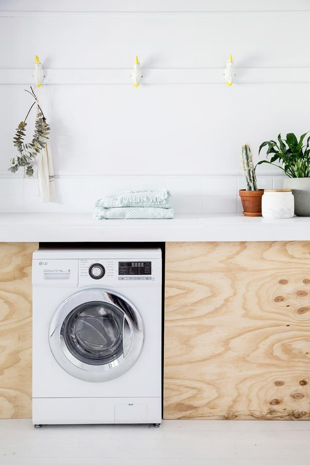 Indoor plants bring this simple laundry room to life. Photo: Chris Warne / *real living*