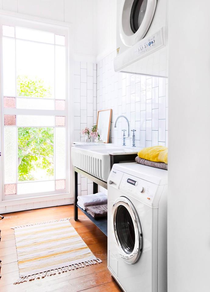 A woven rug enhances the warm colour palette in this laundry. Photo: Maree Homer / *bauersyndication.com.au*