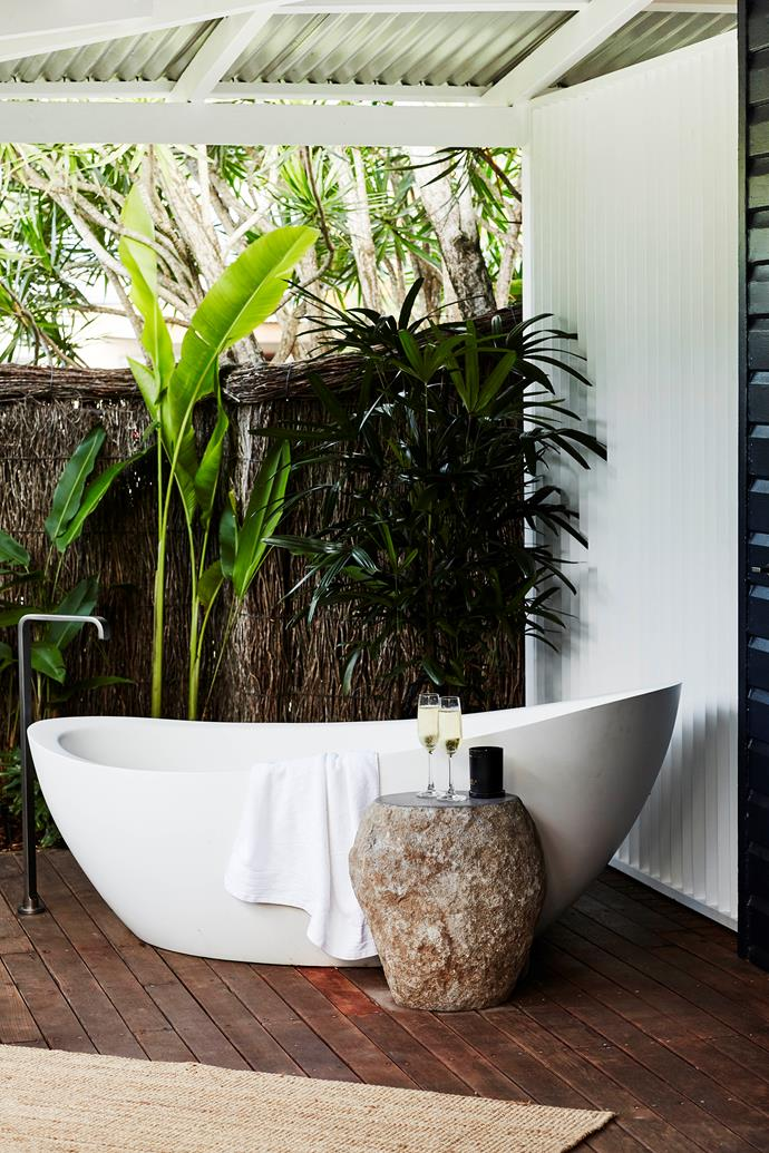 An outdoor bath adds a luxurious element to the outdoor area.