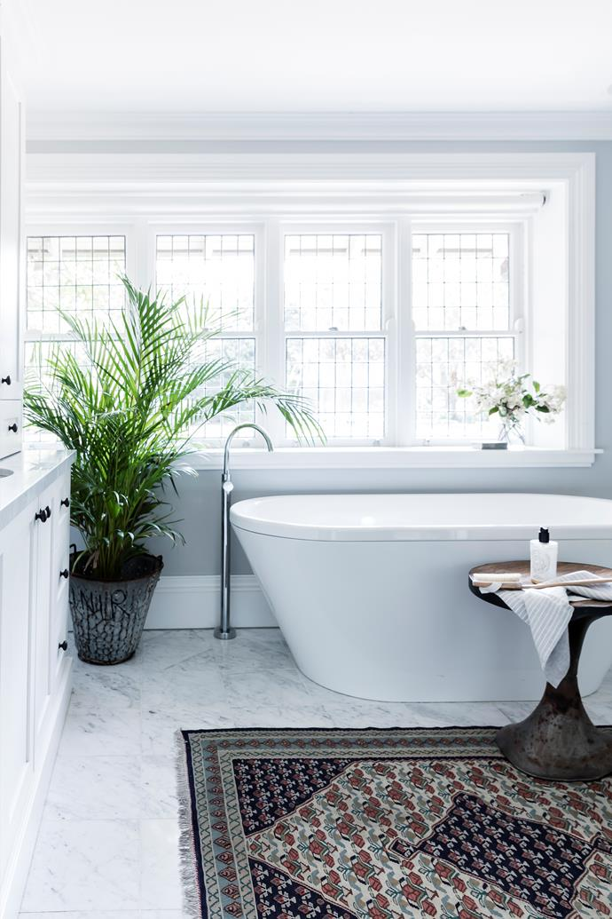 A Dulux paint colour called Tranquil Retreat sets the tone here. The tiles are Carrara marble.