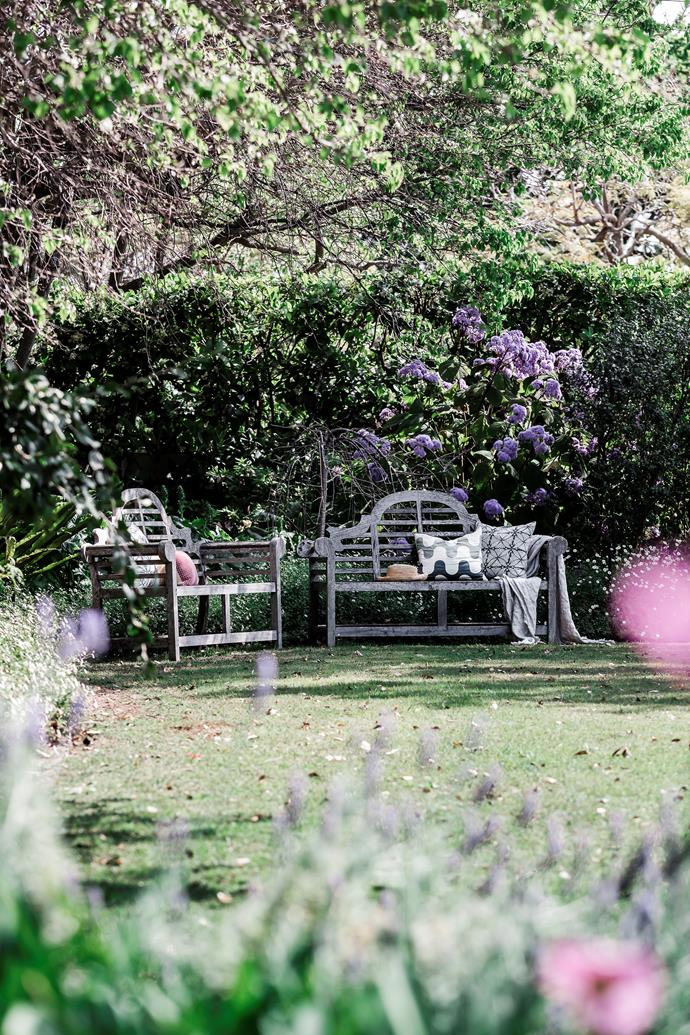 The back of the home was opened up to enjoy views of the garden designed by Michael Bligh.