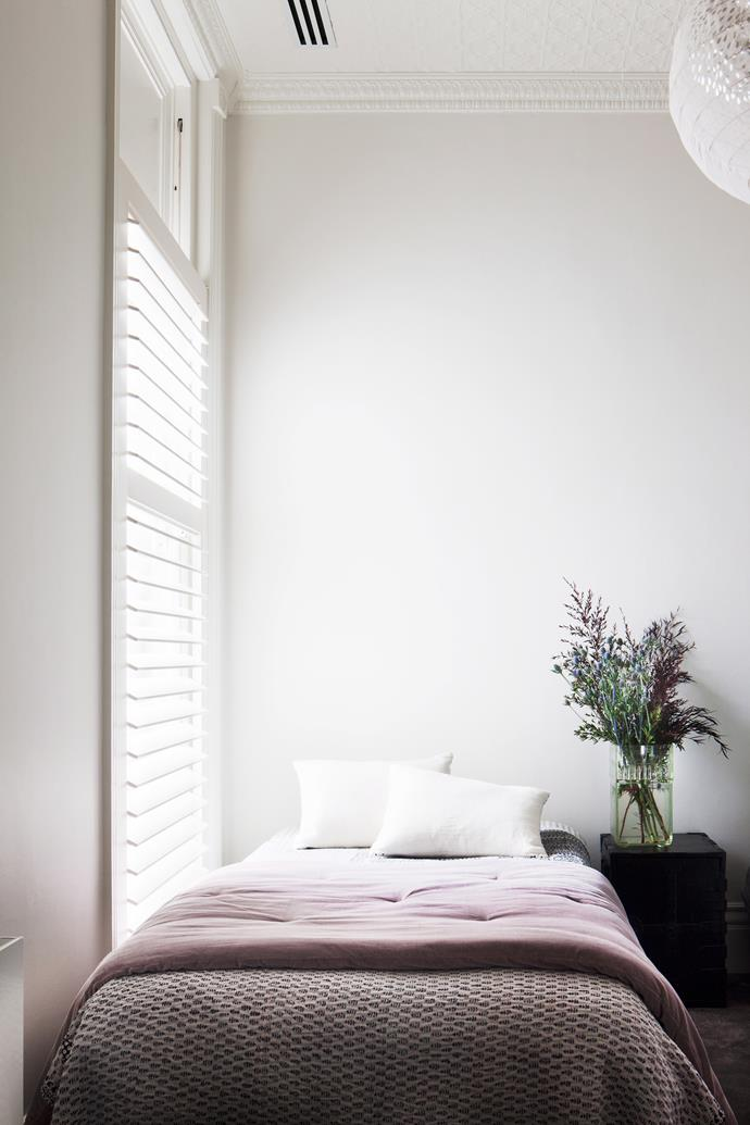 Venetian blinds filter natural light creating a dreamy atmosphere in this bedroom. Photo: Shannon McGrath / *bauersyndication.com.au*