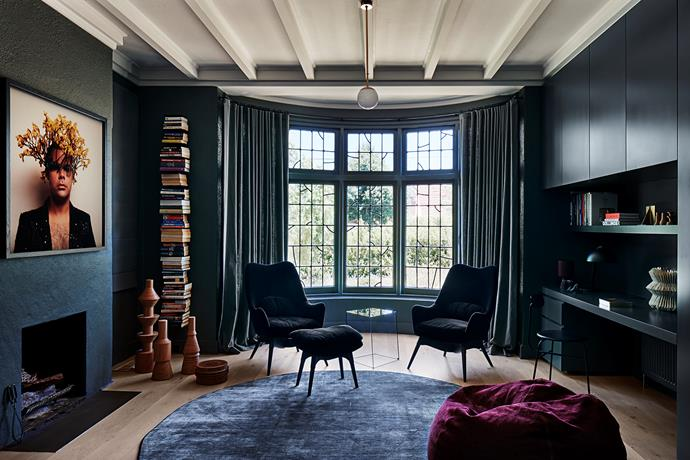 In the study, a pair of Featherston 'E254' chairs from Grazia & Co sit on a silk rug from Woven Treasures. 'Ptolomeo' bookcase from Space.