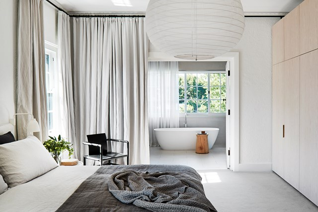 "During the renovation of this formerly [disjointed Melbourne home](https://www.homestolove.com.au/transformation-of-a-large-disjointed-melbourne-home-6913|target=""_blank""), a family bathroom was transformed into a private ensuite bathroom for the master bedroom. Double doors leading to the free-standing tub increase the space's sense of luxury. *Photo: Shannon McGrath / Story: Belle*"