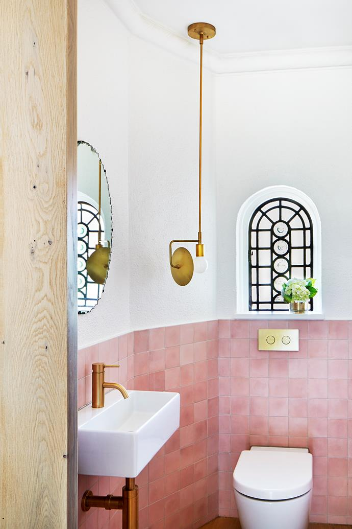 The downstairs powder room has pink cement tiles from Tiento Tiles. Workstead 'Orbit Pendant One' lightfitting.