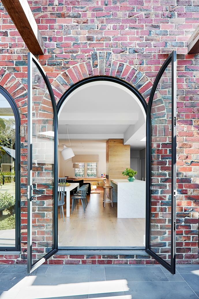 A second arched doorway was added to admit more light, and the new brickwork replicates the old.