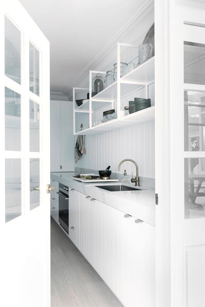 The butler's pantry is perfect for keeping prep mess contained and hidden from view. Scyon 'Axon' cladding. Caesarstone Statuario Maximus benchtop. 'Titan' kitchen mixer, Caroma. French doors from Wideline Windows & Doors.