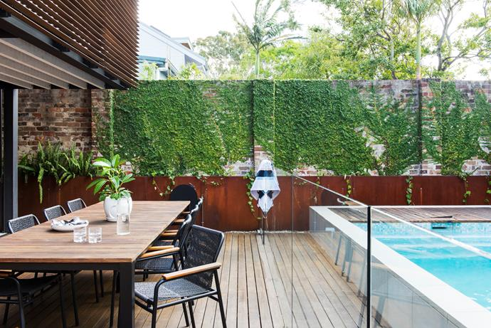 """A simple, low-maintenance zone with a Corten-steel wall housing planter boxes. The raised edge [pool design](https://www.homestolove.com.au/cutting-edge-swimming-pool-design-1951