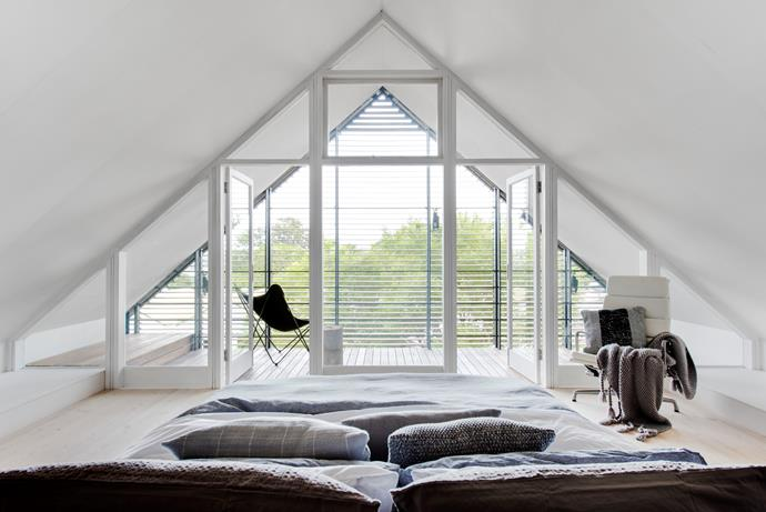 At the top of the three-level home, this light-filled space enjoys cooling cross-breezes in summer. The bed was crafted to sit on a turntable: the owners can spin it towards the windows when they want a view, or have it facing the TV at night.