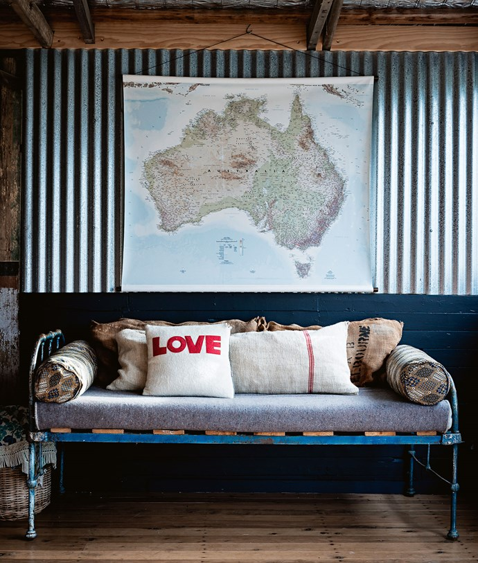 Lanolin-enriched floorboards act as a reminder of the shed's former purpose. The 'love' cushion is from Etsy.