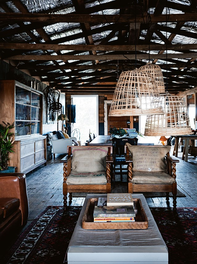 "A keen eye for kerbside finds and a love of salvaged style allowed one creative couple to create their ultimate country escape by [re-purposing an old shearing shed](https://www.homestolove.com.au/shearing-shed-converted-into-guest-quarters-6923 |target=""_blank""). A light-touch approach was taken by the pair, and all of the building's quirky features, including corrugated iron walls and timber ceiling beams have been allowed to take centre stage. *Photo: Michael Wee / Story: Country Style*"