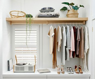 Scandinavian style walk-in wardrobe by Bicker Design