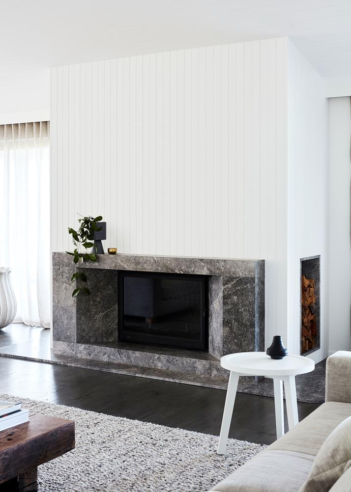 "The fireplace is the epitome of luxe meets coastal. Crisp white timber panelling meets a fireplace in Grey Aether stone from [G-Lux](https://www.g-lux.com.au/|target=""_blank""