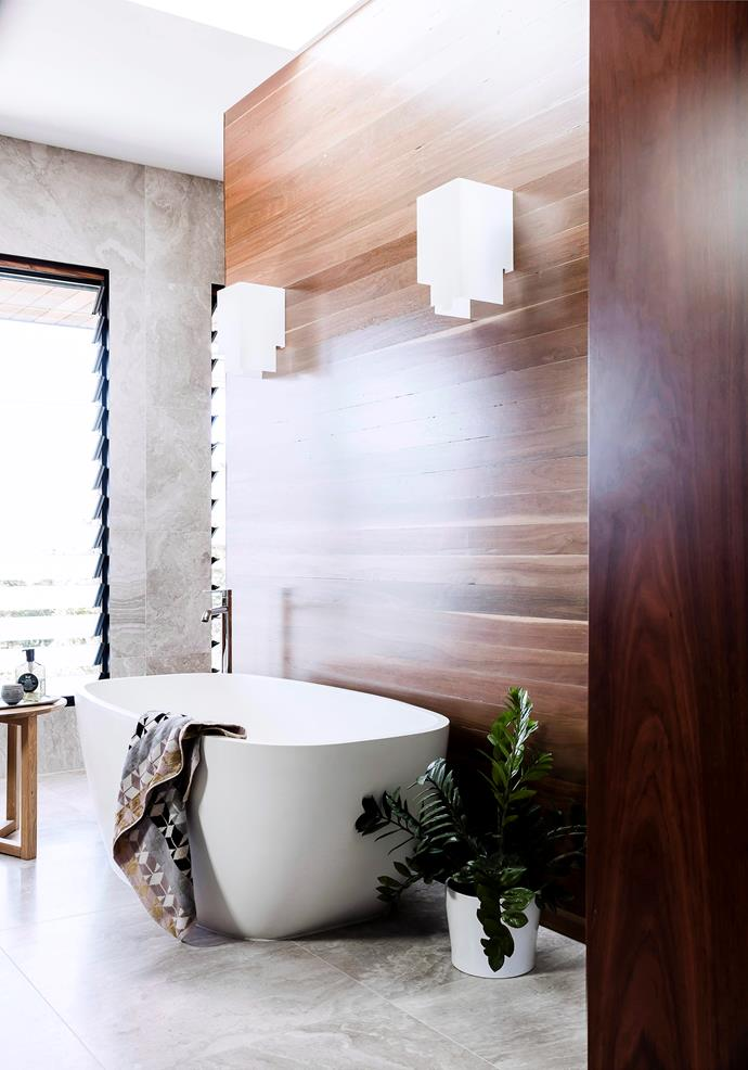 A touch of timber in the bathroom creates a zen-like feel.