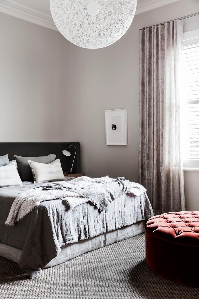 In the master bedroom, a bespoke velvet ottoman and linen bedhead by Hare+Klein, linen by Molteni.