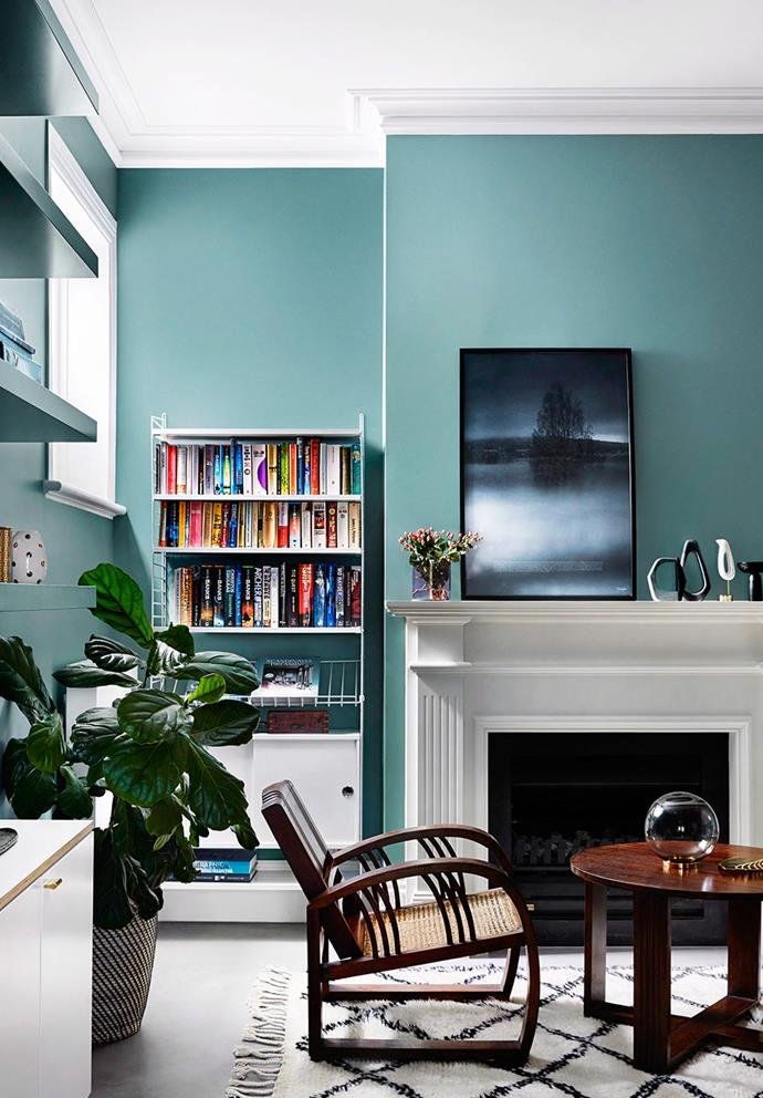Blue-green walls inject a fresh playfulness to this sophisticated Edwardian-style home, while the use of white draws attention to the high ceilings, opening the space. *Photo: Tess Kelly / Bauersyndication.com.au*