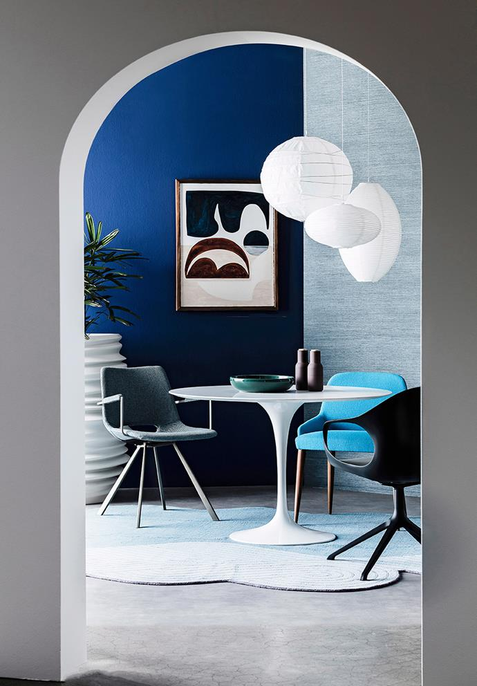 To prevent colour schemes from looking too busy or confusing, always pair a bold colour with a neutral. Start by choosing just one confident colour, and then look for ways to incorporate additional bold colours in lesser amounts. In this dining area, fresh blues and warm greens create a lively yet calming space. The inclusion of fresh greenery and white accents ground the space. *Photo: Maree Homer / Bauersyndication.com.au*