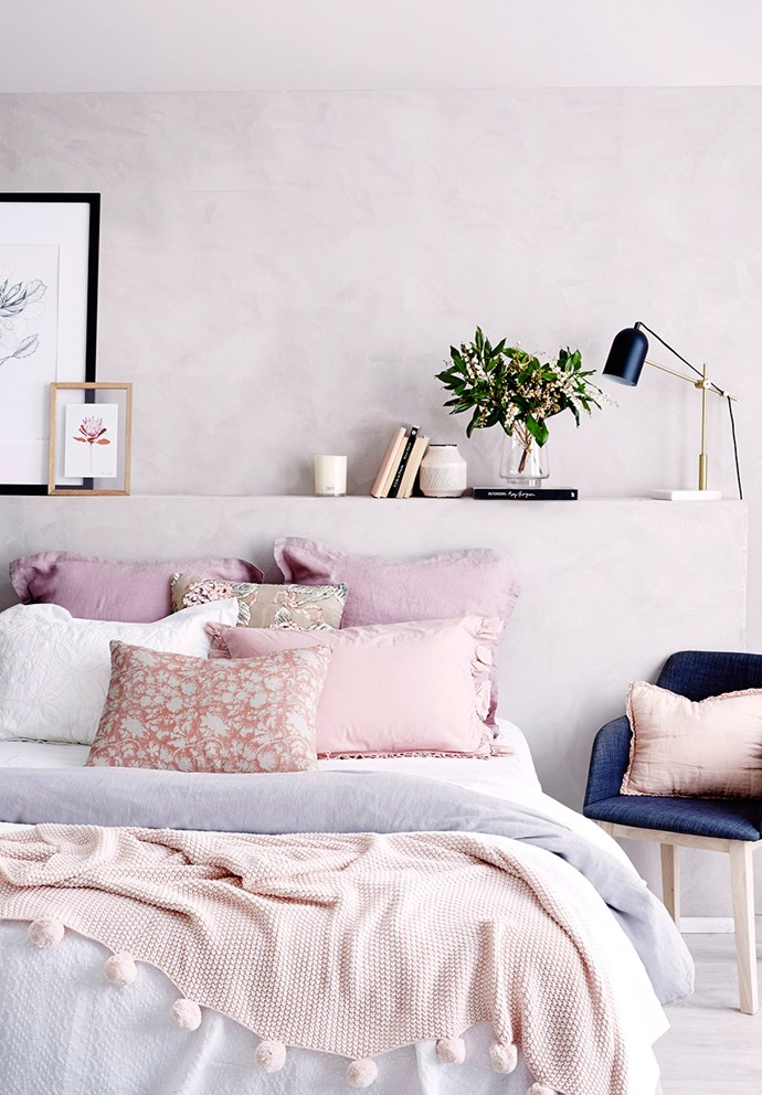 "For a pared-back take on bold interiors, tap into pastels and softer colours. Embodying sentiments of the ['Norsu' interpretation of Scandi-style](https://www.homestolove.com.au/scandinavian-interior-design-6907|target=""_blank"") — a more colourful take on traditional monochrome Scandinavian-style interiors — blush walls give this bedroom a relaxing feel. Teamed with blonde timber and an abundance of artwork, the room allows for subtle colour pops in a non-obtrusive way. *Photo: Kristina Soljo / Bauersyndication.com.au*"