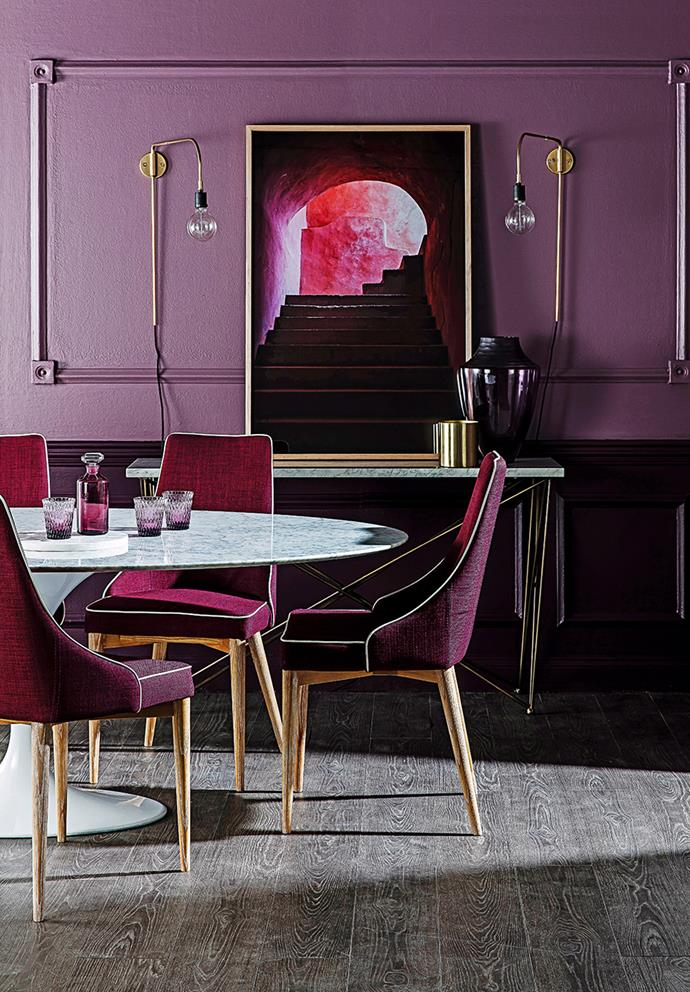 Purple adds richness to interiors and works in both traditional and minimalist spaces. Heavier shades such as plum evoke a regal, more formal tone. Here, light hardwood floor, marble furniture and metallic gold finishes soften the plum statement pieces, with a lighter wall shade helping to add contrast and luxe feel. *Photo: Maree Homer / Bauersyndication.com.au*