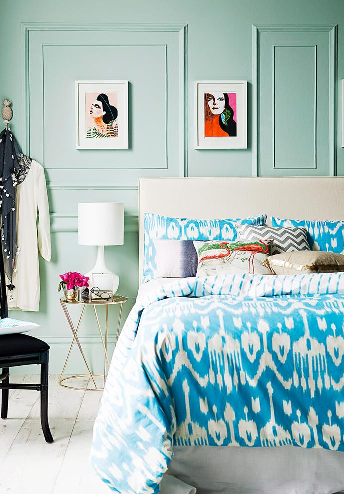Mint green looks effective when complemented with white accents. In this bedroom, white lighting, picture frames and flooring help to punctuate the bold feature wall. *Photo: Chris Warnes / Bauersyndication.com.au*