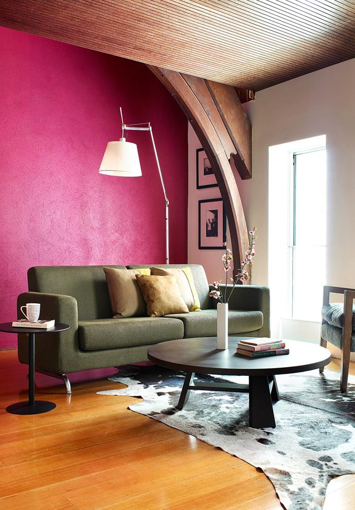 "A quick and inexpensive way to update the home, feature walls are a great place to start when working with high-impact colours — if you don't like it, you can simply paint over it. Look at your existing furniture, homewares and accessories and choose a colour that can be picked up in small doses. Here, pink can be picked up in coffee table tomes and fresh flora. *Photo: Derek Swalwell / Bauersyndication.com.au*  <br><br> *Brought to you by [Taubmans](https://www.taubmans.com.au/homeowners|target=""_blank""