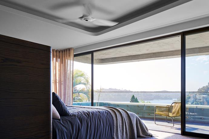 The master bedroom on the middle level looks towards Middle Harbour, with the deep balcony angled to provide optimum views.