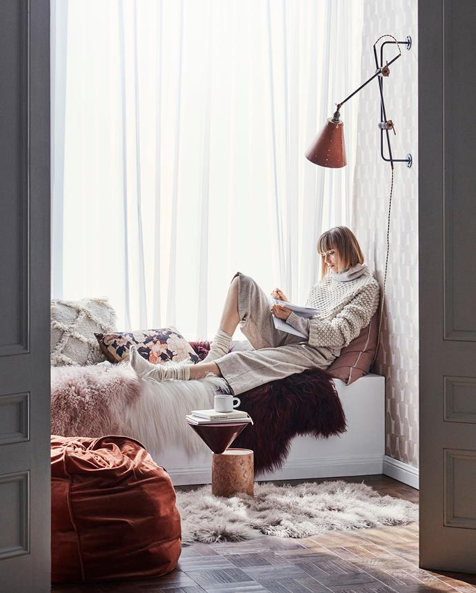 Earthy terracotta tones cosy up this Scandi style reading nook. Photo: Maree Homer | Styling: Kerrie-Ann Jones