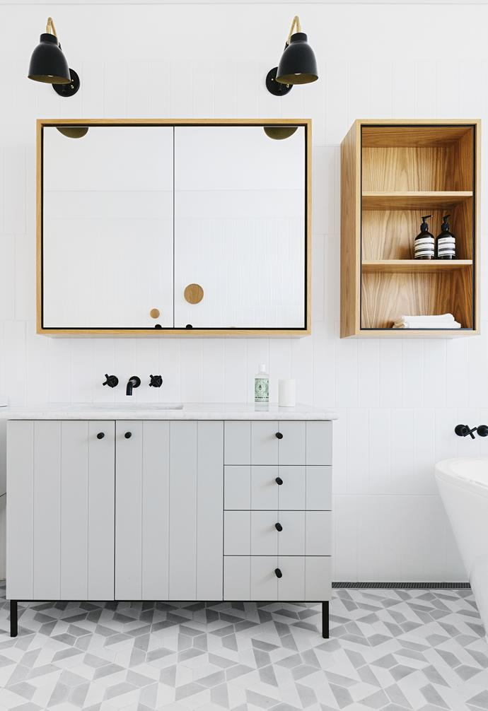 "**One direction** Long, narrow wall tiles are laid vertically to enhance the sense of height in this busy family bathroom. Vertical joint cabinet doors and drawers on the large vanity continue the theme, with geometric floor tiles providing contrast. The timber-veneered mirror cabinet and open shelves add texture and extra storage, essential for family use. *Design: [Arent & Pyke](http://arentpyke.com/|target=""_blank""