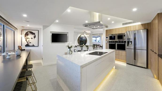 "The [entertainer's kitchen](https://www.homestolove.com.au/8-tips-for-creating-the-ultimate-entertainers-kitchen-4070|target=""_blank"") features LED lighting strips and state-of-the-art stainless steel appliances. *Photo: Domain*"