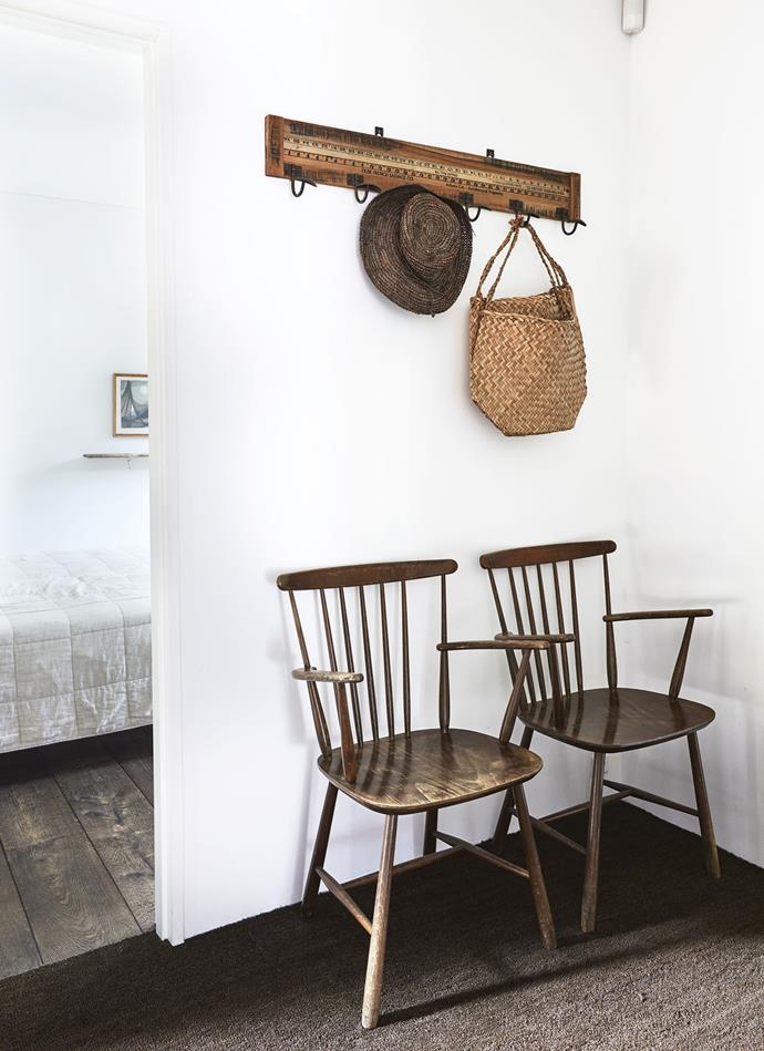 Two old chairs that were found in the shed on the property sit in the hallway. *Photography: Kristian Septimius Krogh | House of Pictures*
