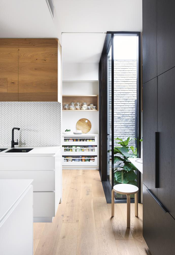 """**On display** Tucked just behind and running parallel to the main kitchen, this space features open drawers and shelving to ensure easy access. *Design: [Heartly](http://heartly.com.au/