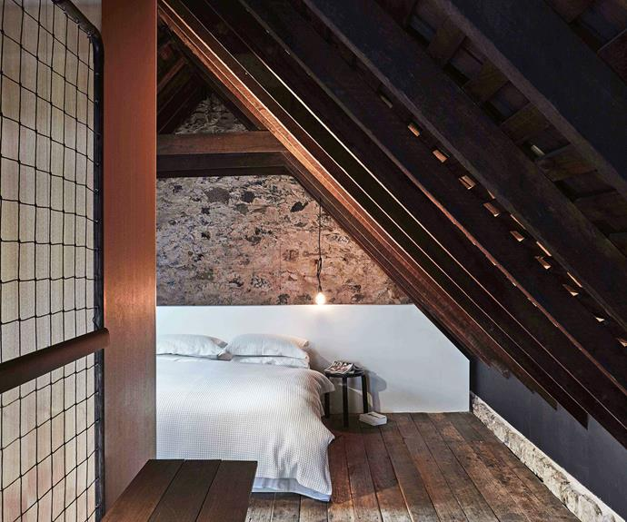 Exposed wooden beams add character to the bedroom at #thebarntas. *Photography: Sean Fennessy*